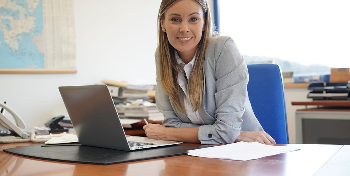 Portrait of businesswoman in office sitting at desk